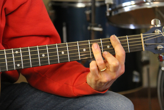 Jeremiah makes chords with his stronger left hand in using neural exercise of music in his recovery.