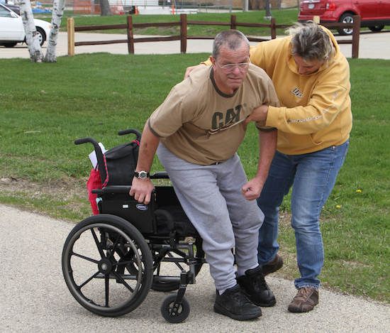 Mike is still in a wheelchair due to injuries to his brain and his TBI physical limitations.
