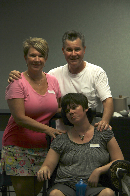 Rita with her parents after her catastrophic brain injury.